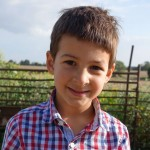 Caleb on farm.JPG
